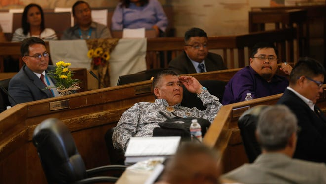 Navajo Nation Council delegates listen on Monday during the first day of the summer session at the Navajo Nation Council Chambers in Window Rock, Ariz.