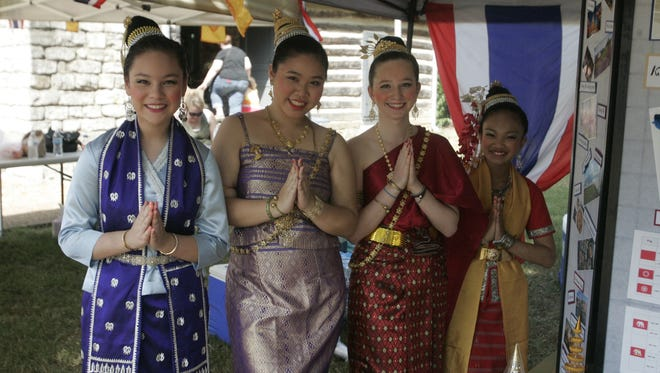 A the Thailand booth, young ladies modeled the beatufil costumes of that country., from left are Tonyaya Wilson, Nicki Phommachieng, Siree McRady and Kaliena Vichitvongsa.