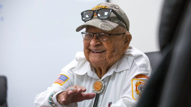 Samuel Sandoval, a Navajo Code Talker, speaks during an interview, Monday at Navajo Transitional Energy Company in Farmington.