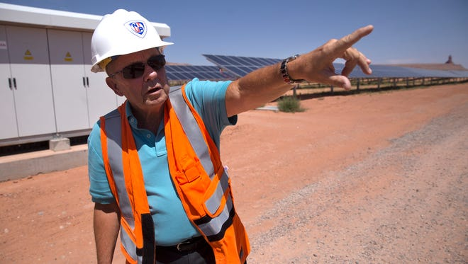Glenn Steiger, project manager for the Kayenta Solar Project leads a tour of a solar farm that is up, running and selling power just over a year after the project broke ground in 2016.