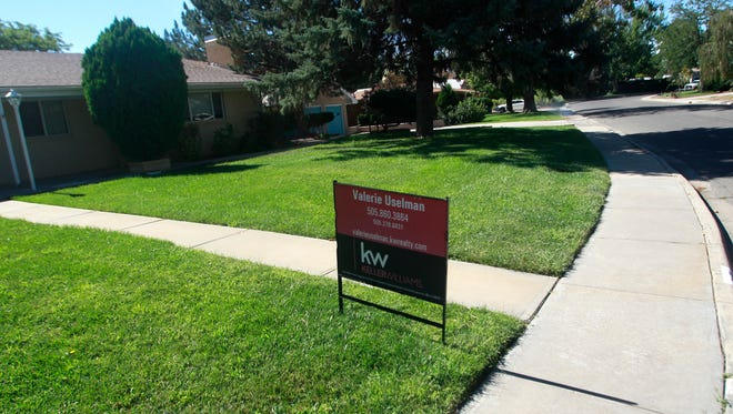 Real estate signs large and small dot the landscape in Farmington this August. Selective prospective buyers last month shopped from an inventory of more than 660 homes that were on the market.