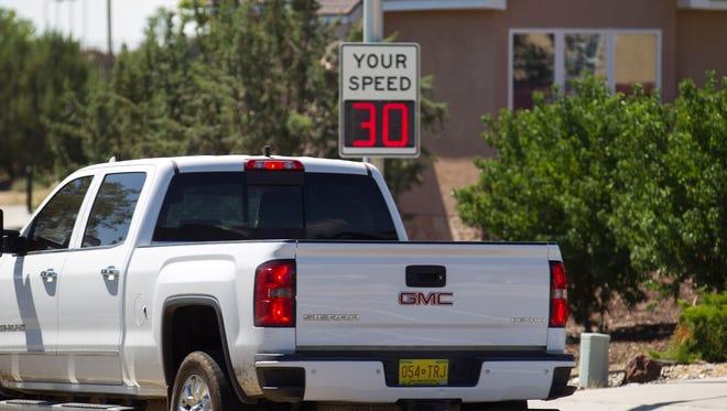 Vehicles move past Colinas Del Norte Park on Tuesday on North Dustin Avenue in Farmington.