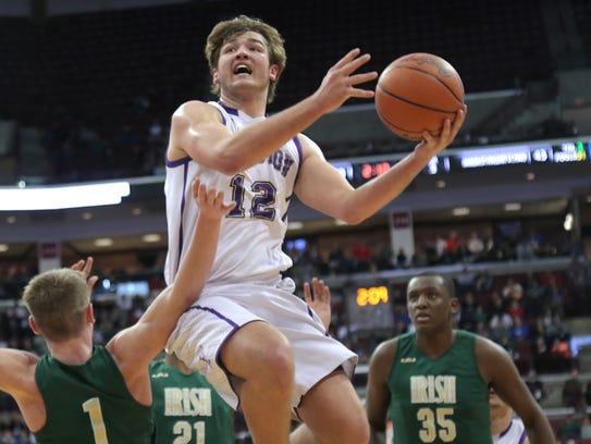 Lexington's Ben Vore makes a jump shot during state