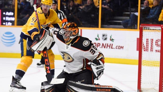 Anaheim Ducks goalie Ryan Miller (30) deflects the shot during the third period against the Nashville Predators at Bridgestone Arena.