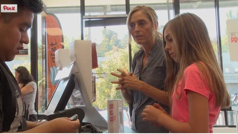 "In a scene from the film ""Screenagers,"" Dr. Delaney Ruston buys her daughter, Tessa, her first smartphone."
