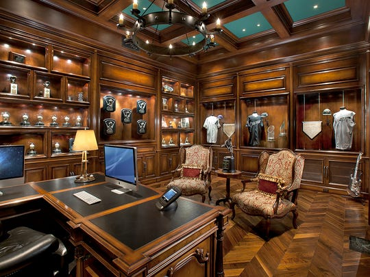 Randy Johnson's home office includes memorabilia from his two-no hit games and the Diamondbacks' 2001 World Series victory, as well as his five Cy Young awards.