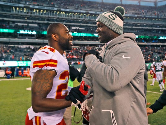 Kansas City Chiefs' Darrelle Revis, left, greets New York Jets coach Todd Bowles after an NFL football game Sunday, Dec. 3, 2017, in East Rutherford, N.J. The Jets won 38-31. (AP Photo/Julie Jacobson)