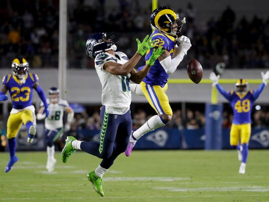 Rams cornerback Troy Hill breaks up a pass intended for Seahawks wide receiver Tyler Lockett during a game on Dec. 8.