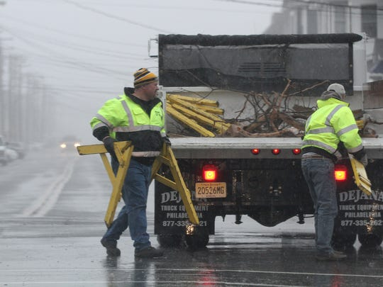 Manasquan Public Works employees close Brielle Road because of flooding Tuesday, March 14, 2017.