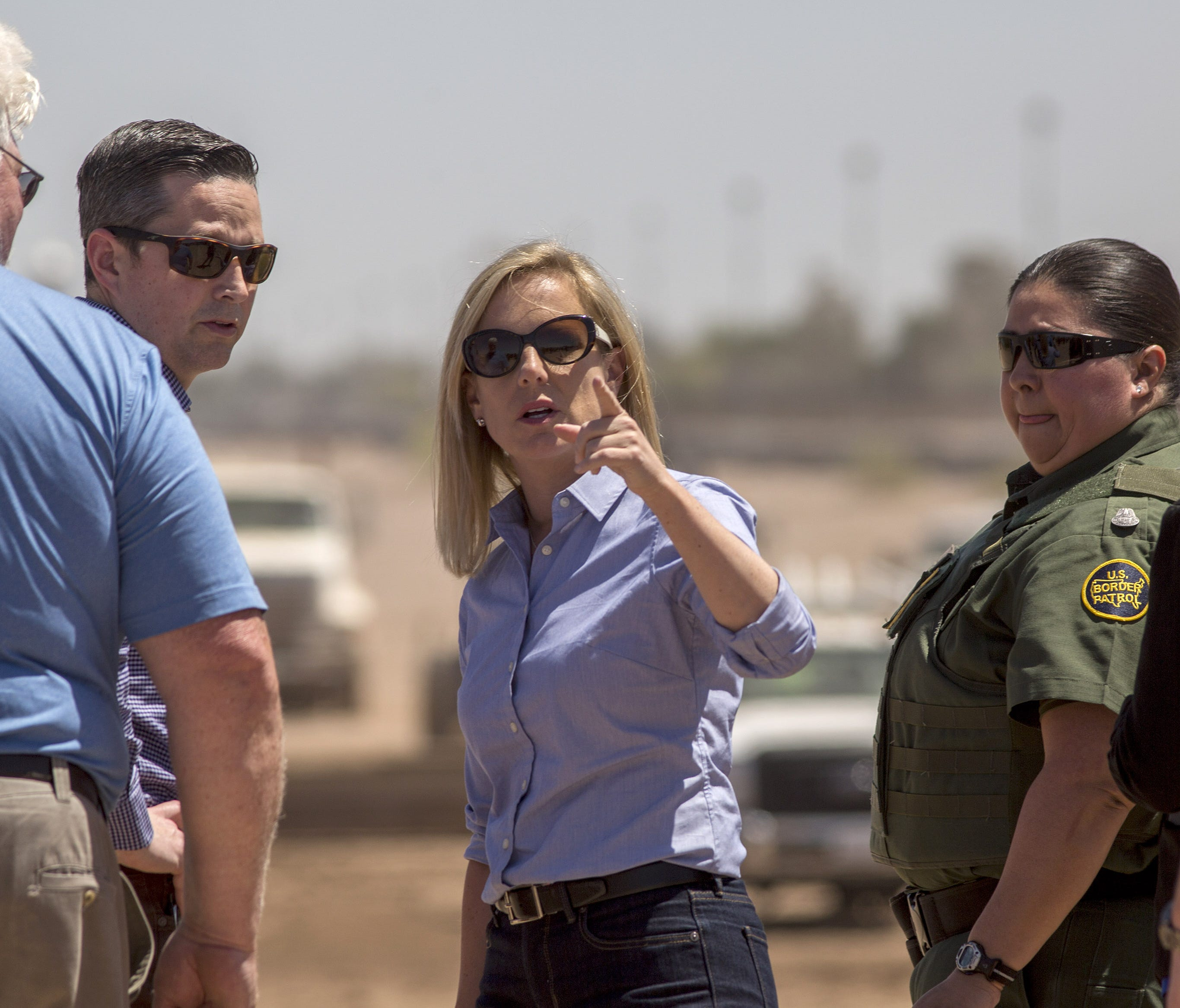 U.S. Department of Homeland Security Secretary Kirstjen Nielsen tours a replacement border wall construction site on April 18, 2018 in Calexico, Calif.