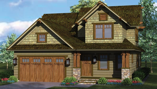 Paired porch columns and exposed brackets add subtle charm to the exterior of this bungalow.