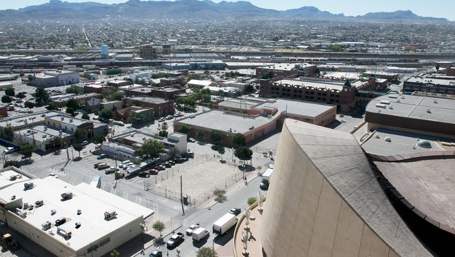 A photograph shows the area where the city plans to build a multipurpose arena. It will be built south of the Judson F. Williams Convention Center in the Union Plaza District.