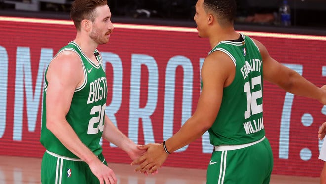 Boston Celtics forward Gordon Hayward (20) celebrates with forward Grant Williams (12) after defeating the Miami Heat in game three of the Eastern Conference Finals of the 2020 NBA Playoffs at ESPN Wide World of Sports Complex on Sept. 19, 2020.
