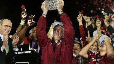 Florida State coach Jimbo Fisher hoists the Coaches' Trophy after defeating Auburn for the national championship in January.