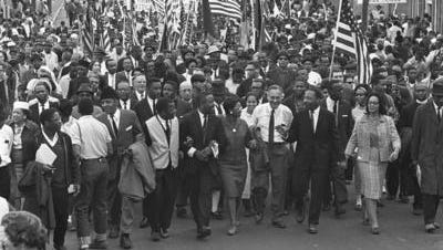 Marchers stream across the Alabama River by way of the Edmund Pettus Bridge on March 21, 1965, the first of a five-day, 50-mile march to the state Capitol. The march route from Selma to Montgomery has been designated a national historic trail.