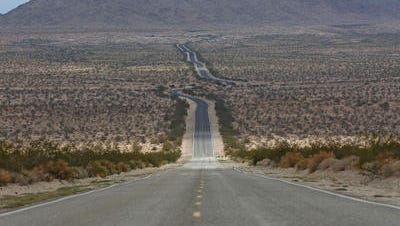 Highway 62 connects to roads in the Mojave Desert, which are used as a shortcut to Las Vegas. Road crews are removing potholes that have been there for months.