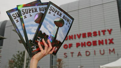 Daren Easterling of Tampa Fl, sell programs for twenty dollars prior to Super Bowl XLII Sunday, Feb 3, 2008 at the University of Phoenix Stadium in Glendale, Arizona.