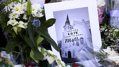 A memorial at Emanuel African Methodist Episcopal Church on Thursday (6/18/15) in Charleston, S.C. Nine people were killed in a mass shooting Wednesday during service at the historic Black church.
