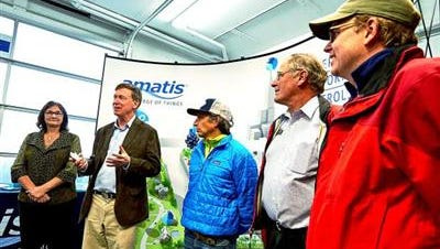 Gov. John Hickenlooper, second from left, speaks during a ribbon-cutting ceremony for Amatis Controls' new manufacturing facility in the Aspen Business Center. Local elected officials who attended were Pitkin County commissioners Rachel Richards, Steve Child and Rob Ittner, as well as Aspen Mayor Steve Skadron, third from right.