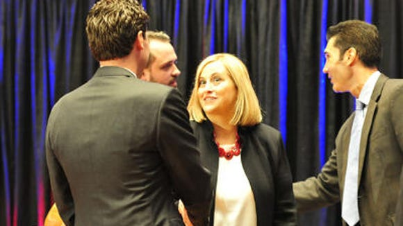 Megan Barry shakes hands with Jeremy Kane at a mayoral debate in June. Barry hopes to attract some of Kane's supporters for the runoff election.