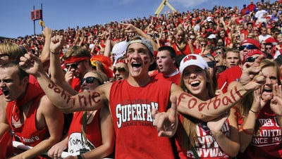 St. John's fans celebrate in the student section during the first half of a game against St. Thomas in 2012.