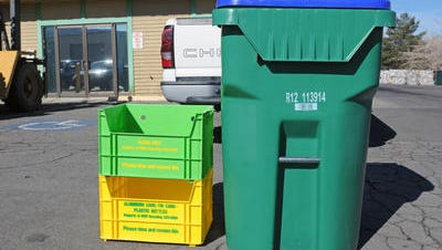 Waste Management's single-stream recycling program in Reno eliminated the need for crates separating glass and plastic. They were replaced by the single cart, right, with a blue top denoting it as a recycling cart. Sparks City Council is considering a similar recycling program for Sparks.