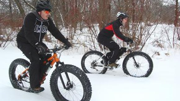 Fatbikes seem to be more than a passing fancy for people interested in riding bike in the winter. Advocates say those big tires help soak up bumps, have better traction and make cold weather riding fun. Bob Dunahee, left, and Gary Barden ride their fat bikes at Oak Island Park in January, 2013.
