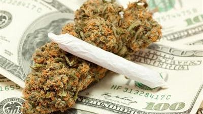 The U.S. Federal Reserve has asked a federal judge in Denver to dismiss a lawsuit by a credit union asking a judge to force its hand and charter a bank for marijuana businesses.