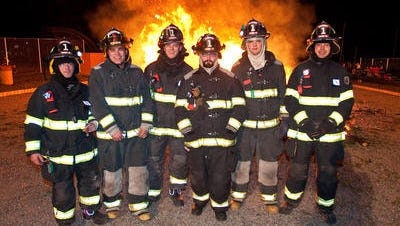 (L-R) MCWTW Brookside Fire Company firefighters Nick Witczak, Christian Kalweit, his brother Robby, Rich Brusco, Andrew Jacobson and Eric Cooper at the annual Mendham Borough Fire Department Christmas tree burn at Broough Park in Mendham Borough, January 8, 2011.
