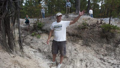 Emile DeVito of the New Jersey Conservation Foundation stands in a forest section illegally denuded by off-road trucks that use Wharton State Forest as a playground