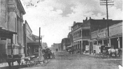Main Street in Lafayette in 1914. The 1859 Lafayette Parish Courthouse is on the left.
