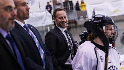 SUNY Geneseo hockey coach Chris Schultz was named SUNYAC coach of year for his leadership under the most trying circumstances.