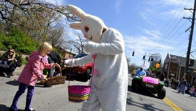 The Easter Bunny hands out candy along the Frankfort Avenue Easter Parade route in 2009.