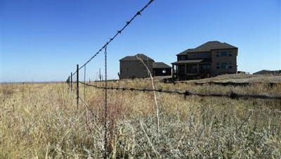 A $375 million settlement has been reached in a long-running class action lawsuit between operators of the former Rocky Flats nuclear weapons plant and thousands of homeowners who lived downwind of the facility.