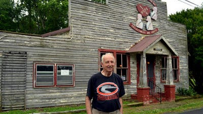 In this 2014 Daily Times file photo, Jack Willing Sr., executive director of Skipjack Heritage Inc., stands in front of the former Corbett country store in Chance that is home to the organization, which recently was approved more than $72,000 toward the creation of the Skipjack Museum and Heritage Center.