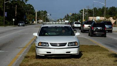 Palm Bay and Melbourne police are searching for suspects in a used car dealership break-in
