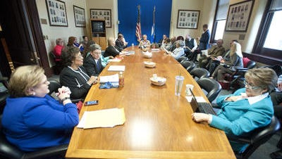 The Louisville Metro Council's Democratic caucus meeting in City Hall's third-floor conference room.