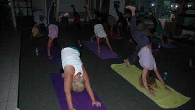 Participants flex and stretch at a  yoga and Pilates  class at Rotary Park Environmental Center.