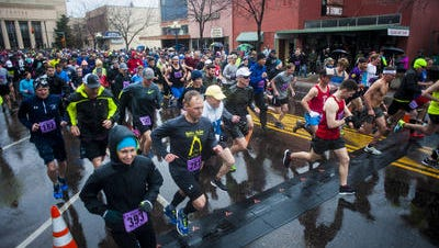 Runners start the five mile race during the 38th Annual Ice Breaker Sunday, April 23.