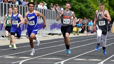 Havre's Jacob Labrie (516) leads competitors in the class A 400 meter dash at the State A meet in Laurel.