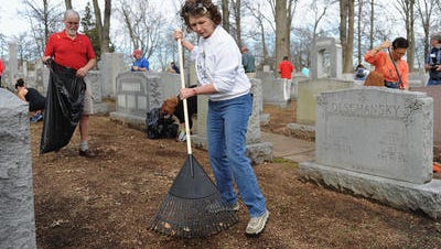 Volunteers clean up Chesed Shel Emeth Cemetery in February 2017. The cemetery in Missouri was one of the latest targets of vandalism.