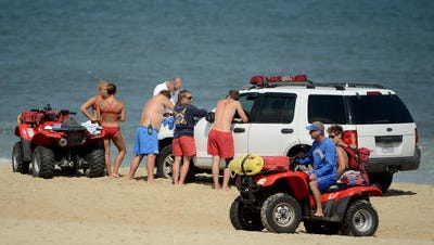 This 2015 Daily Times file photo shows surf rescue technicians performing an exercise on the beach in Ocean City. On Friday, July 28, rescuers pulled a beachgoer from the ocean after the person suffered a suspected medical episode.
