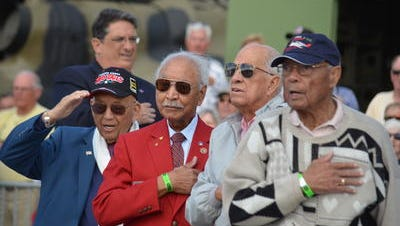 """U.S. Air Force retired Lt. Col. Bob Friend, left, and U.S. Army Air Force Capt. Isham """"Rusty"""" Burns, second from right, are former Tuskegee Airmen who plan to attend the National Championship Air Races in Reno, Nev., next weekend. They will be there with a P-51 Mustang the Palm Springs Air Museum is sending up to participate in the races and a tribute to the Tuskegee Airmen."""