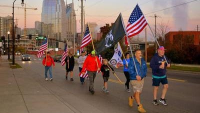 Jim Retzke, front left, leads a group in 2015 in his annual 32-mile Fallen Soldiers March from Nashville to Lebanon.