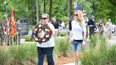 VFW Auxiliary 3323 members Molly Wright and Kristi Hoff laid a wreath in memory of those who died serving the country during the annual Wayne Westland Memorial Day Parade and ceremony in this 2016 file photo. The committee that plans the annual celebration announced this year it had canceled the event due to lack of participation.