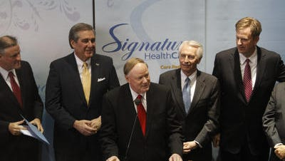 Joe Steier, far right, in 2010, with U of L President James Ramsey, Kentucky Gov. Steve Beshear,  and Louisville Mayor Jerry Abramson, as Signature Healthcare's move from Florida to Louisville is announced