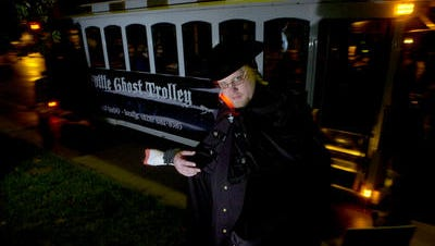 Joshua P. Warren prepares to lead a tour on the Asheville Ghost Trolley in 2007.