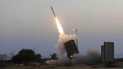 The Iron Dome air defense system fires to intercept a rocket from the Gaza Strip on Saturday.; An Iron Dome air defense system fires to intercept a rocket from Gaza Strip in the costal city of Ashkelon, Israel, on July 5.