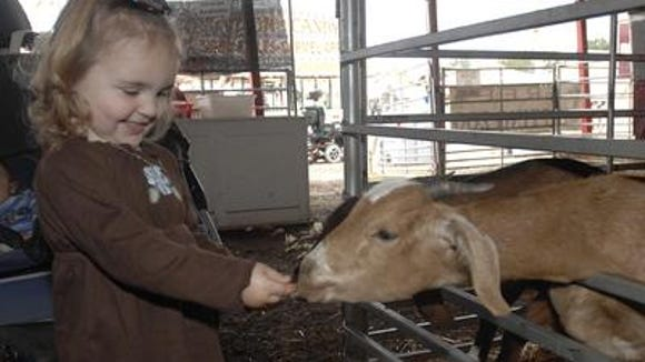Lillie Bradshaw enjoys the Petting Zoo at the Mississippi State Fair.