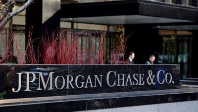 This December 12, 2013 file photo shows the headquarters of JP Morgan Chase on Park Avenue in New York. JPMorgan Chase, the nation's largest bank by assets, said Tuesday its second-quarter earnings fell 9 percent as revenue at its investment banking and mortgage businesses dropped.